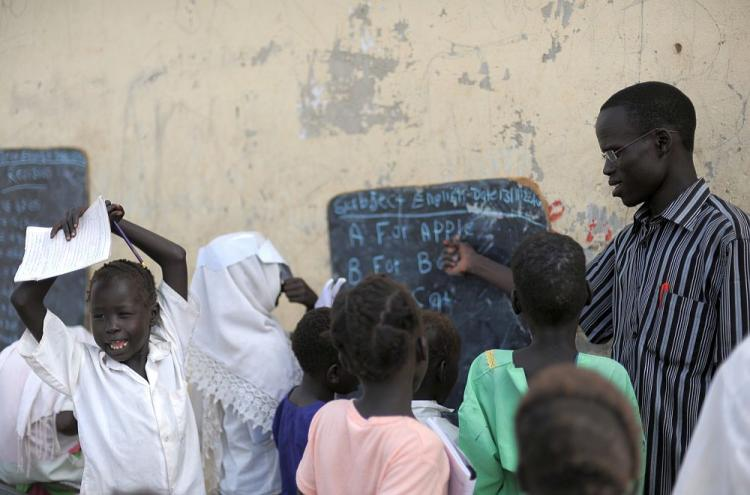 Students take part in an English class at a government school in Bentiu on November 13, 2011. (Roberto Schmidt/AFP/Getty Images)