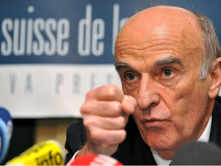 Swiss President and Finance Minister Hans-Rudolf Merz gestures during a press conference on the financial crisis, banking secrecy and international relations at the Geneva press club earlier this month in Geneva.  (Fabrice Coffrini/AFP/Getty Images)