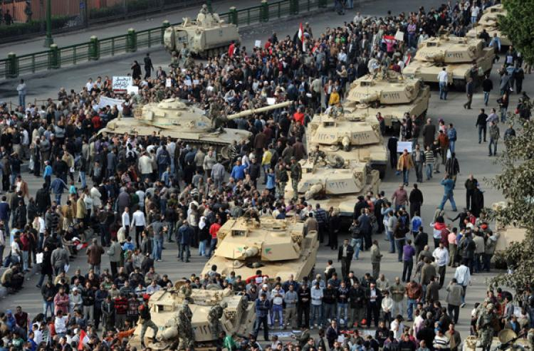 SHOW OF POWER: A column of Abrams tanks line the street as Egyptian demonstrators gather in Tahrir Square in Cairo, on Jan. 30, on the sixth day of unprecedented protests against President Hosni Mubarak's regime. (Miguel Medina/Getty Images )