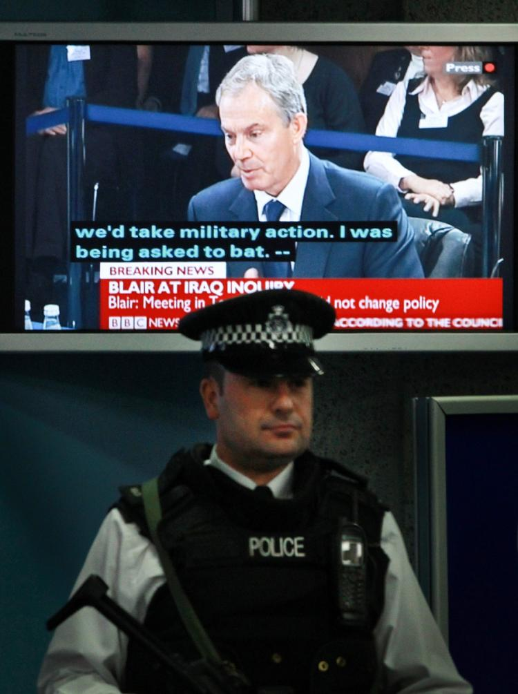 TESTIMONY: Former U.K. Prime Minister Tony Blair is seen on a television screen during The Iraq Inquiry on January 21 in London. (Peter Macdiarmid/Getty Images)