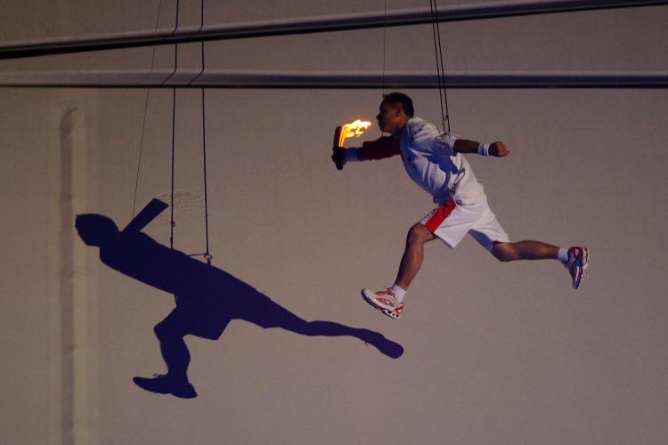 HUNG UP: Li Ning, former Olympic gymnast for China flys through the air on his way to lighting the Olympic Flame during the Opening Ceremony for the 2008 Beijing Summer Olympics at the National Stadium on August 8, 2008 in Beijing, China. (Phil Walter/Getty Images)