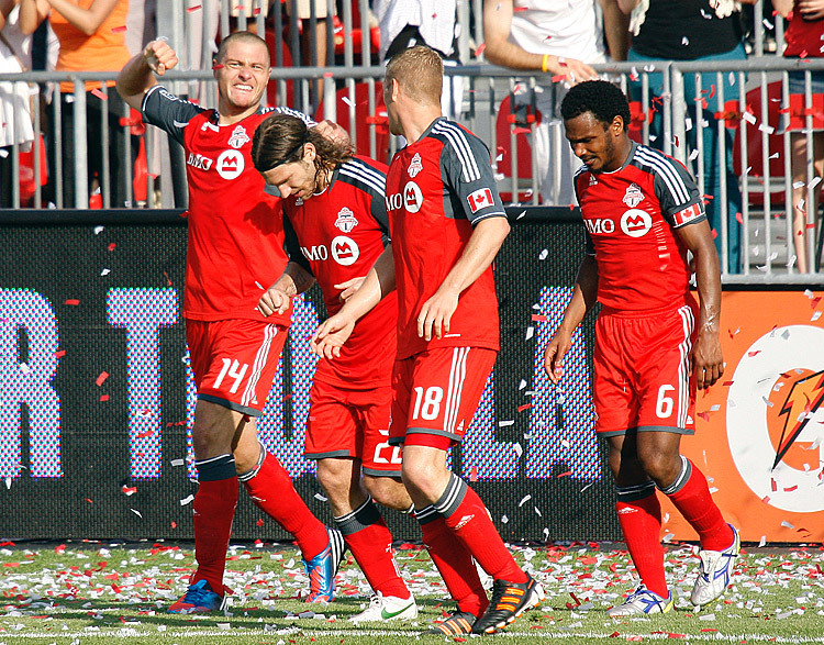 Toronto FC's Danny Koevermans (L) celebrates with his teammates after scoring the game-winning goal against the Philadelphia Union at BMO Field on Saturday. (Abelimages/Getty Images)