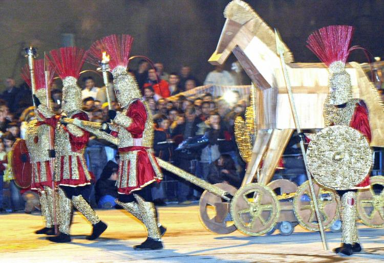Macedonians dressed as ancient spearmen drag a 'Trojan horse' during the Strumica carnival, in February 2004. (Robert Atanasovski/AFP/Getty Images)