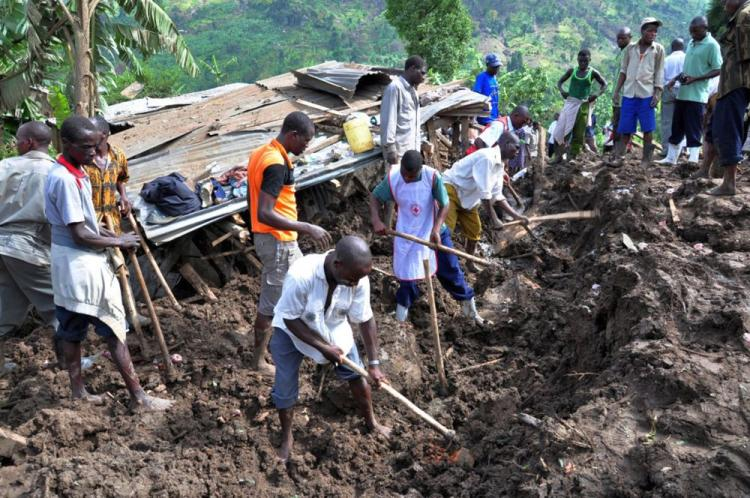 Residents of Mbale dig in search of bodies in the debris of the landslide March 3 in eastern Uganda. A landslide triggered by torrential rain has buried entire villages and left more than 300 people missing in Eastern Uganda, where at least 55 people have been killed. (Peter Busomoke/AFP/Getty Images)