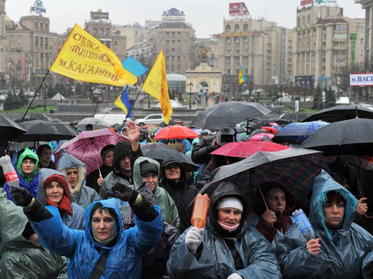 PLEASE LISTEN: Small- and medium-sized business owners rally in Kyiv, on Nov. 23, 2010, against the proposed new unified tax laws, which went into force on Jan. 1. The new rules have increased the tax burden on small businesses forcing many out of business. (Sergei Supinsky/Getty Images)
