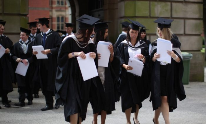 In this file photo, students at a UK university graduate on July 14, 2011. A few UK universities may be facing serious financial problems following losses caused by the CCP virus pandemic, the IFS said on July 6, 2020. (Christopher Furlong/Getty Images)