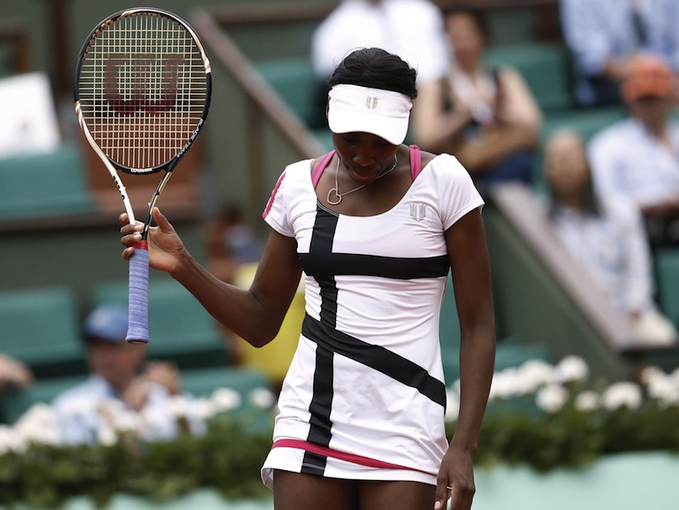 US Venus Williams reacts after a point a