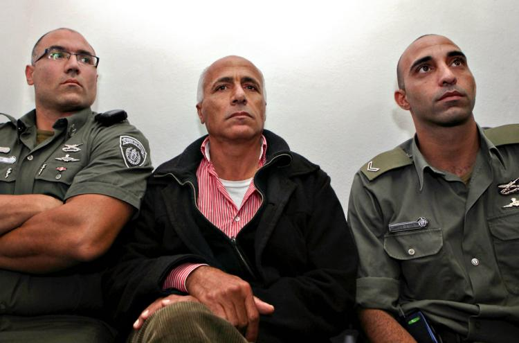 SENTENCED: Israeli nuclear whistle-blower, Mordechai Vanunu, sits between Israeli policemen at a Jerusalem court on Dec. 29, 2009. Vanunu has spent nearly two decades in prison for revealing confidential details about Israel's Dimona Nuclear plant. Vanunu was sentenced to three months in jail because of breaking the conditions of his parole, by talking to foreigners. (Gali Tibbon/AFP/Getty Images)