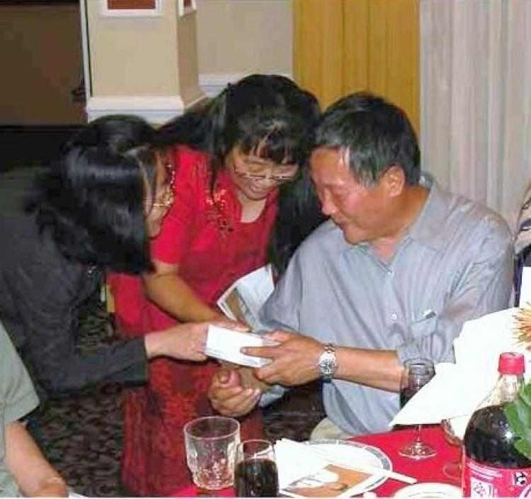 Wei Jingsheng (right), a leading China democracy advocate, is celebrated on his 60th birthday by friends and well-wishers. The celebration was at a Washington, D.C. suburb, May 22. (Wei Jingsheng Foundation)
