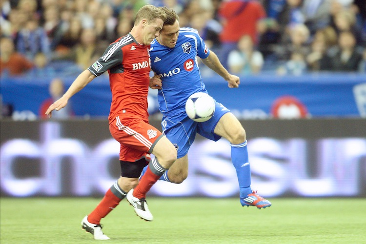 Montreal's Andrew Wenger (R) gets past Toronto FC's Ty Harden in MLS action on Saturday. (Richard Wolowicz/Getty Images)