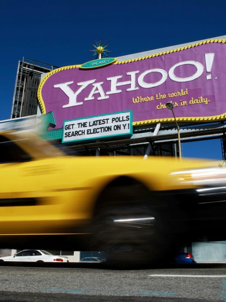 TAKEOVER TARGET? A taxicab drives by a Yahoo billboard in San Francisco, Calif. Yahoo is involved in speculation that the company may be a target for corporate takeover.  (Justin Sullivan/Getty Images)