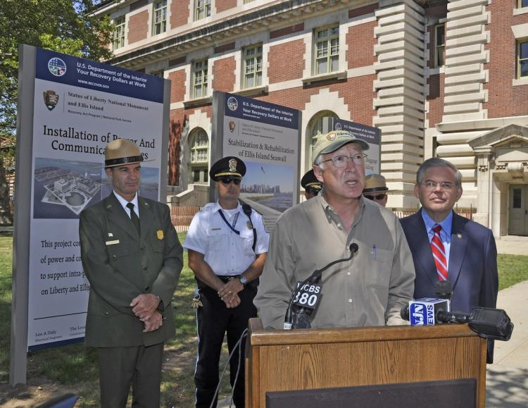 Secretary of the Interior Ken Salazar (C), Sen. Robert Menendez (R), Dave Luchsinger, superintendent of the Statue of Liberty and Ellis Island (L), at a press conference for announcing three restoration projects planned on Ellis and Liberty islands, July 26.  (Kevin Daley/National Park Service)