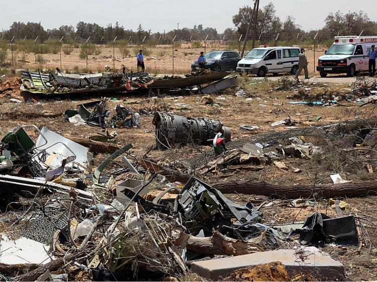 A picture shows the crash site of an Afriqiyah Airways passenger plane in Tripoli on May 13, 2010. (Mahmud Turkia/AFP/Getty Images)