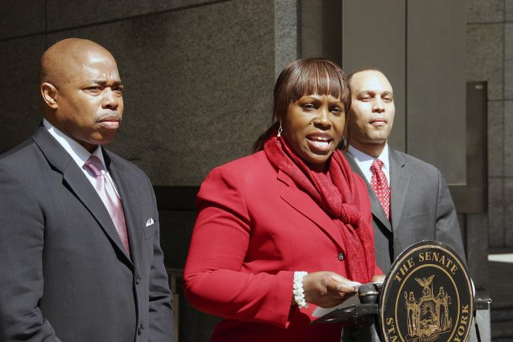 MAKING A LIST: State Sen. Eric Adams (L), Assemblywoman Vanessa Gibson (C), and Assemblyman Hakeem Jeffries propose new legislation Sunday that will require convicted domestic violence offenders to register their crimes in a database.  (Ivan Pentchoukov/The Epoch Times)