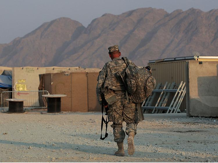 An American soldier walks with his equipment October 27, 2009 at Forward Operating Base Wilson in Kandahar Province, Afghanistan. (Chris Hondros/Getty Images)