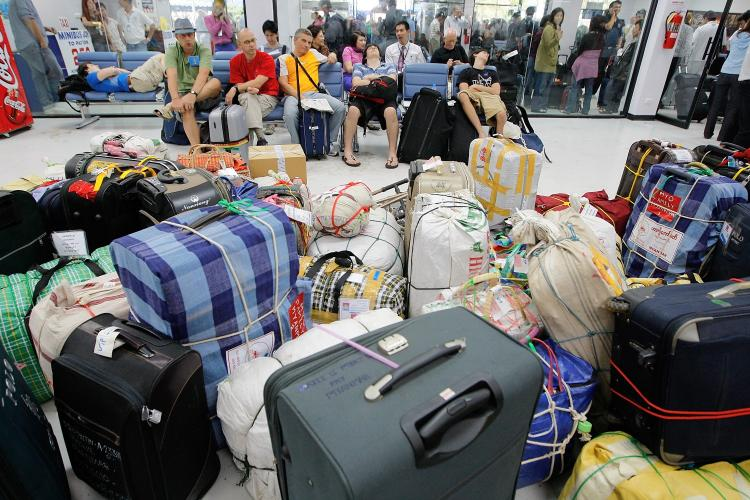 Travelers and their luggage pack the overcrowded U-Tapao military airport 165 km (102 miles) south of Bangkok, November 30, 2008 in Pattaya, Thailand. (Paula Bronstein/Getty Images)