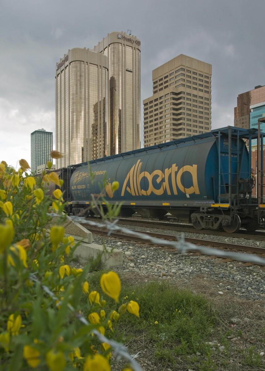 Freight trains cross through the Calgary