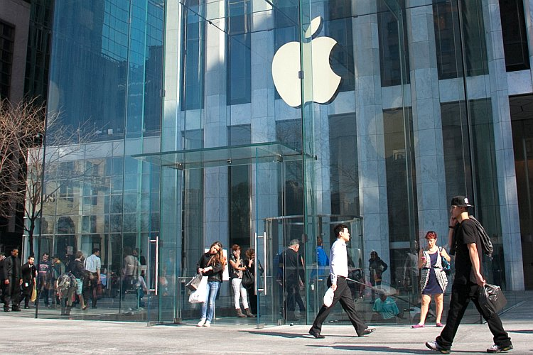 People shop at Apple's Flagship store on Fifth Avenue in New York