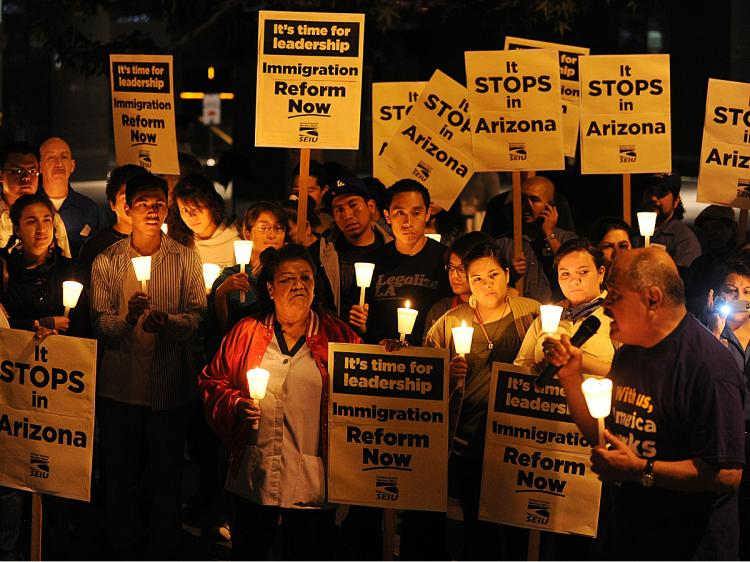 Mexican and Latino janitors hold a candlelight vigil calling for federal immigration reform, in response to the tough new Arizona law giving the police new stop and search powers, outside their workplaces in Los Angeles on May 20, 2010. (Mark Ralston/AFP/Getty Images)