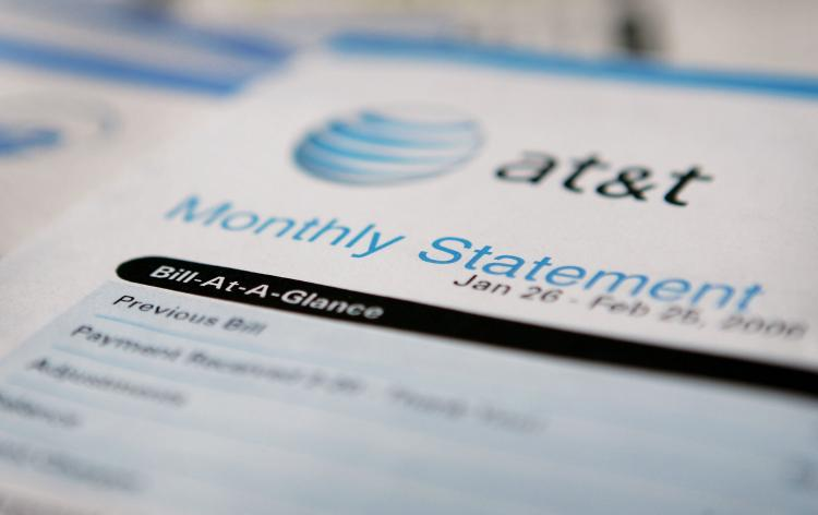 A file photo of an AT&T bill. The telecommunications giant announced that it was entering the cloud computing fray with its own offering. (Scott Olson/Getty Images)