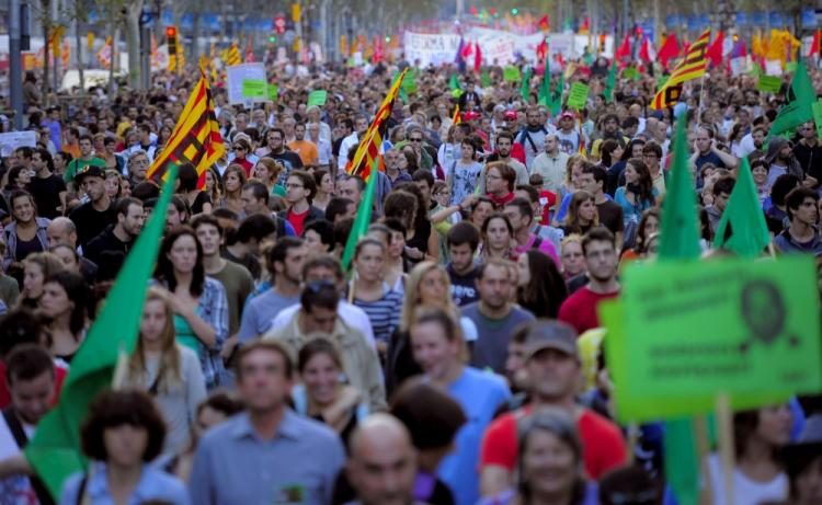Austerity Protests: Demonstrators walk with flags, placards and banners in central Barcelona during the general strike held in Spain on September 29, 2010. (Josep Lago/AFP/Getty Images)