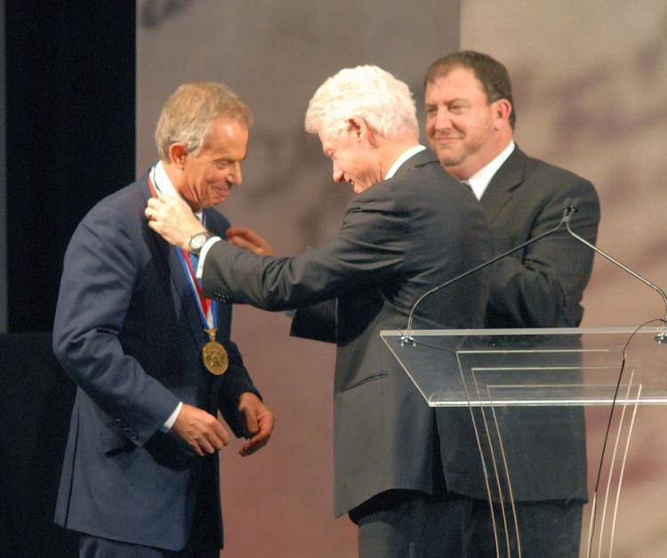 Former U.S. President Bill Clinton (C), along with National Constitution Center's President David Eisner (R), presents former Prime Minister Tony Blair the 2010 Liberty Medal at the National Constitution Center Sept. 13 in Philadelphia, Pennsylvania. Blair won the medal for his work to broker peace in Northern Ireland and Kosovo, and promote peace and economic opportunities in the Middle East and Africa. (William Thomas Cain/Getty Images)