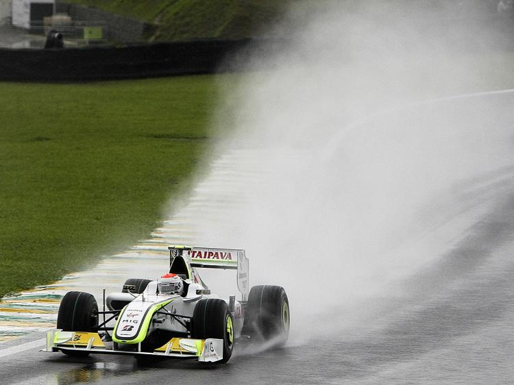 Brazilian Formula One driver Rubens Barrichello battles the wet to put his his Brawn GP onto the pole of the Brazilian F1 Grand Prix, on October 17, 2009, at Interlagos racetrack in Sao Paulo, Brazil. (Orlando Kissner/AFP/Getty Images)