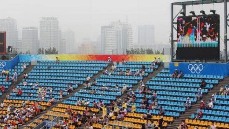 A general view of Beijing's Chaoyang Park Beach Volleyball Ground is pictured with the city of Beijing in the background during the Women's preliminary beach volleyball matches on August 13, 2008 at the 2008 Beijing Olympic Games. (Thomas Coex/AFP/Getty Images)