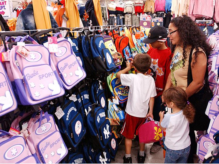 The Benevides family shops for school bags and back to school clothes at Cookies in the Brooklyn borough of New York City.    (Stephen Chernin/Getty Images )