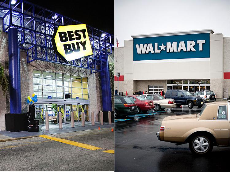 Wal-Mart (Jeff Zelevansky/Getty Images) and Best Buy (Matt Stroshane/Getty Images) are offering deals on electronics on Black Friday. ()