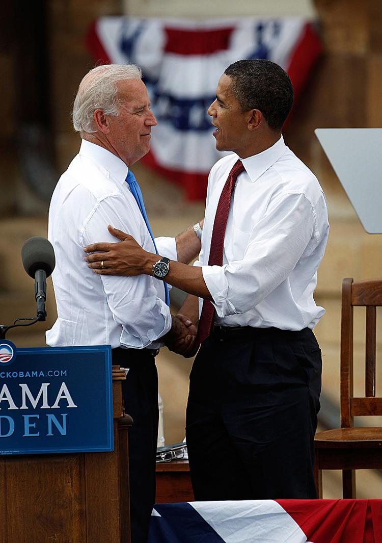 Democratic presidential candidate Senator Barack Obama (R) greets Senator Joe Biden during a rally on the lawn of the Old State Capital August 23, 2008 in Springfield, Illinois. (Scott Olson/Getty Images)