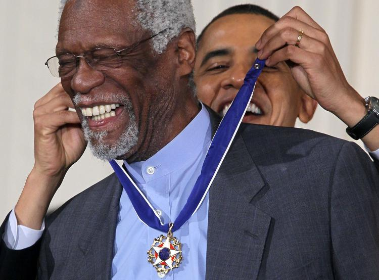 Bill Russell (L) is presented with the 2010 Medal of Freedom by U.S. President Barack Obama during an East Room event at the White House on Feb. 15 in Washington, D.C. (Alex Wong/Getty Images)