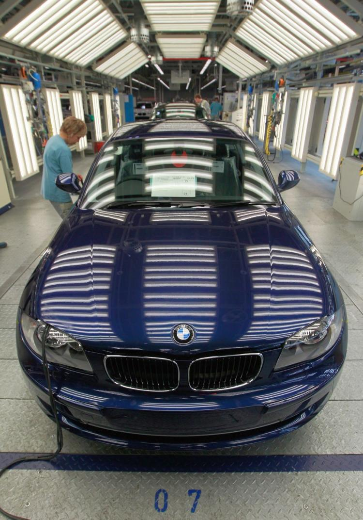 A worker makes a final visual inspection of a completed BMW car at the BMW auto assembly plant in Leipzig, Germany on Nov. 5, 2010. Lead by a surging automotive industry, business confidence in Germany hit an all-time high in January, as the European Union�s biggest economy boosted its exports and increased consumer household consumption, and unemployment fell to 7.0 percent. (Sean Gallup/Getty Images)