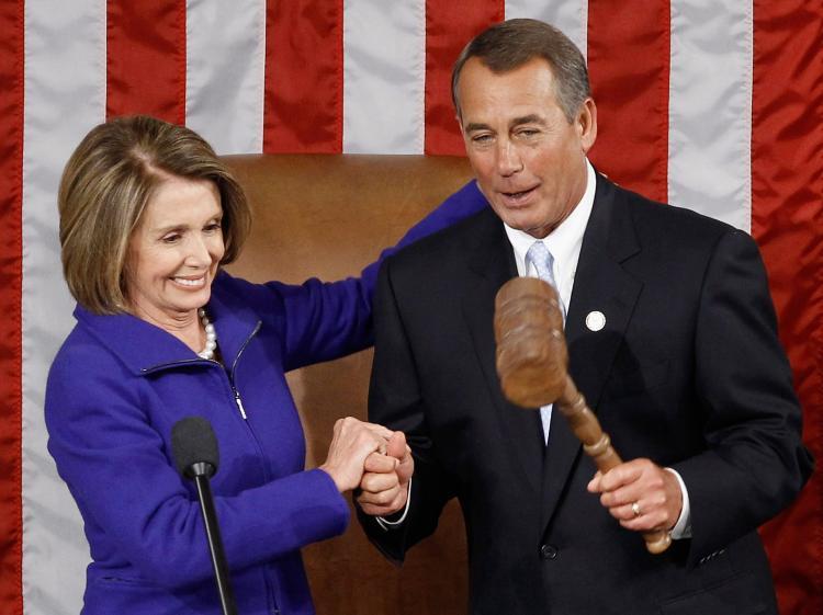 Speaker of the House John Boehner (R) receives the Speaker's gavel from outgoing Speaker of the House Nancy Pelosi January 5, 2011 in Washington, DC.  (Chip Somodevilla/Getty Images)