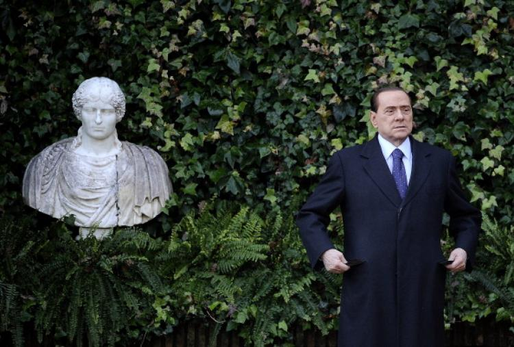 Italian Prime Minister Silvio Berlusconi gestures as he arrives in Rome's Villa Madama for a meeting with Slovenia's President Danilo Turk on January 18, 2011. (Filippo Monteforte/AFP/Getty Images)