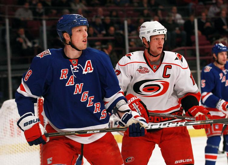 New York's defenseman Marc Staal couldn't prevent his brother Eric from scoring on Wednesday at Madison Square Garden. (Bruce Bennett/Getty Images)