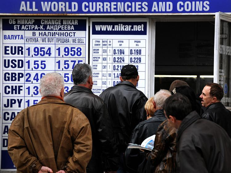 Bulgarians line up in front of a currency exchange office in Sofia.  (Dimitar Dilkoff/AFP/Getty Images)