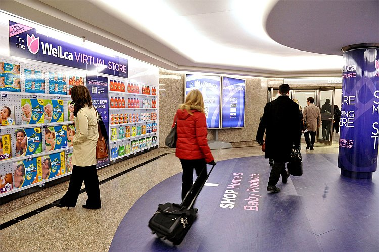 Commuters browse Canada's first virtual store in downtown Toronto