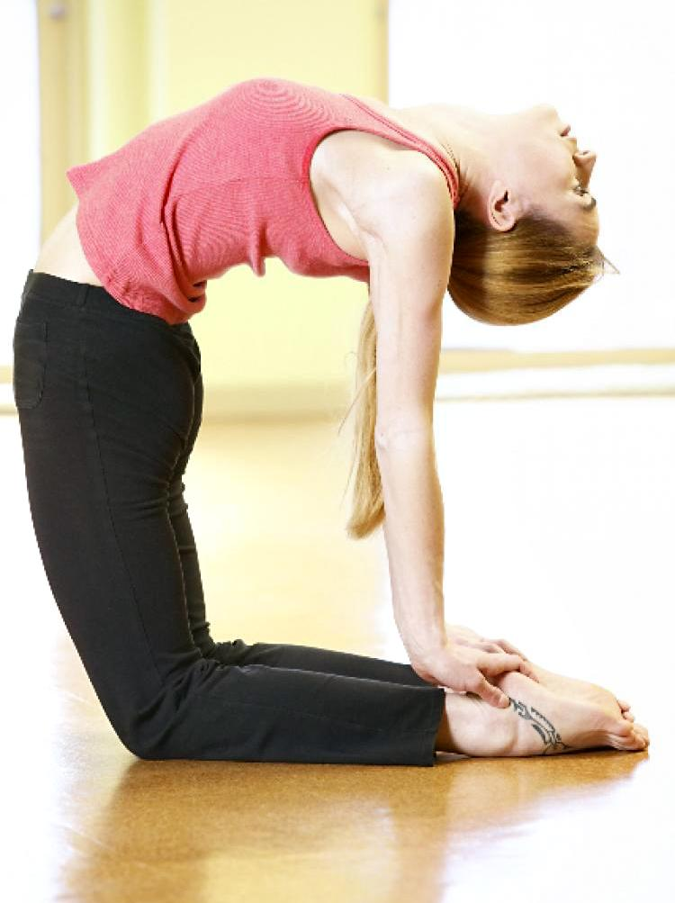 The camel pose helps lift one's mood, open one's heart, and deepen one's breath. (Photos.com)