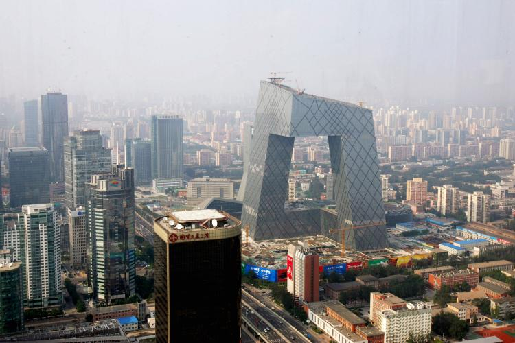 The new angled building of the state-run Chinese Central TV (CCTV) headquarters (centre) dominates the surrounding area in Beijing. (China Photos/Getty Images)