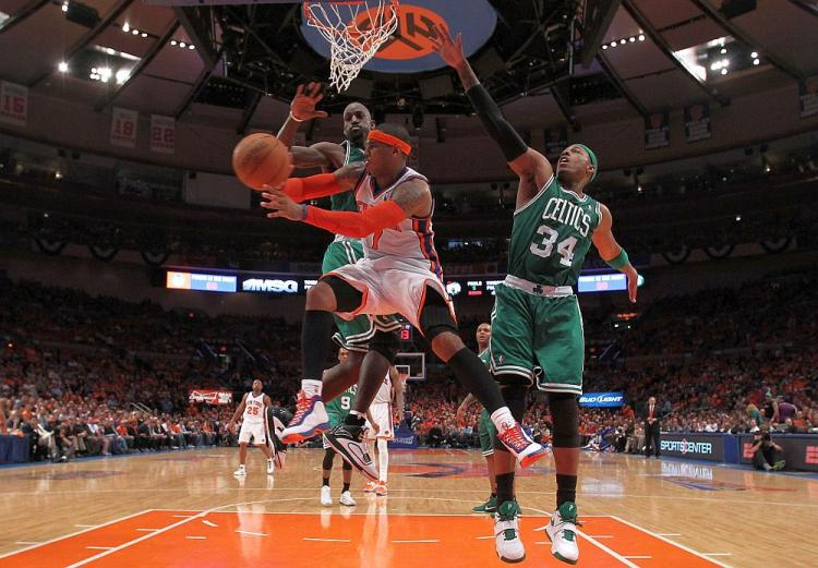 GOOD DEFENSE: Paul Pierce and Kevin Garnett put excellent defensive pressure on Carmelo Anthony on Sunday afternoon in Game 4 of the Eastern Conference first round playoffs. (Nick Laham/Getty Images)