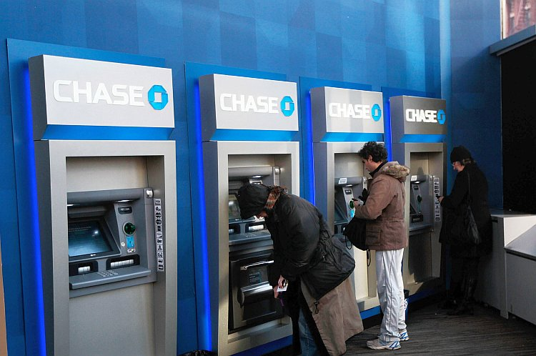 People use ATMs at a Chase branch bank in New York City.