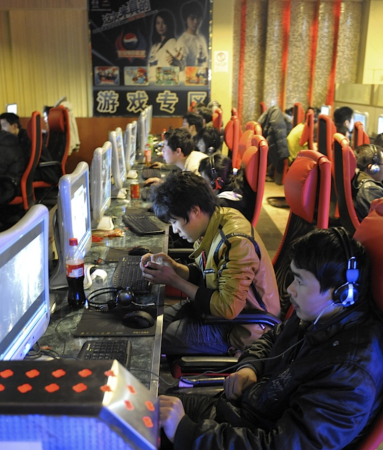 Chinese netizens play online games at an internet cafe in Beijing