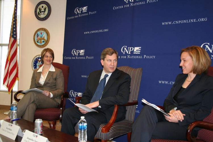 Jacqueline Newmyer (r), president and CEO of Long Term Strategy Group, and Kristen Gunness (l), advisor to the U.S. Department of the Navy, discuss the implications of today's economic downturn on China's military plans, while Scott Bates (center), vice-p (Gary Feuerberg/The Epoch Times)