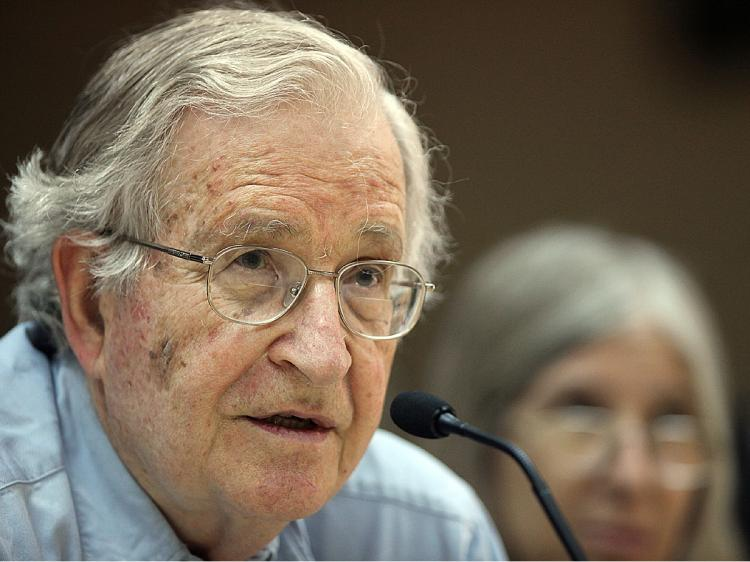 Renowned Jewish-American scholar and political activist Noam Chomsky speaks during a scheduled lecture at Bir Zeit University by video conference from Jordan University in Amman on May 18, after he was officially barred from entering Israel and the West Bank.(Khalil Mazraawi/AFP/Getty Images)