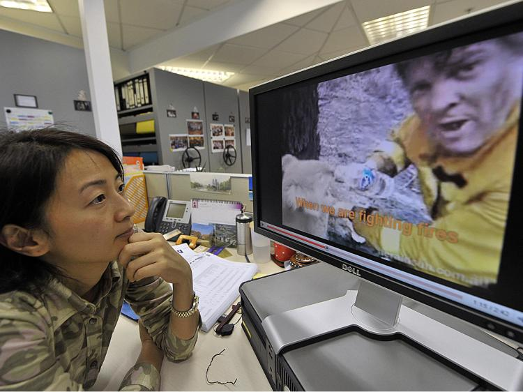 A woman watches a YouTube video in Hong Kong. Chinese YouTube clones will be heavily regulated by the regime. (Mike Clarke/AFP/Getty Images)