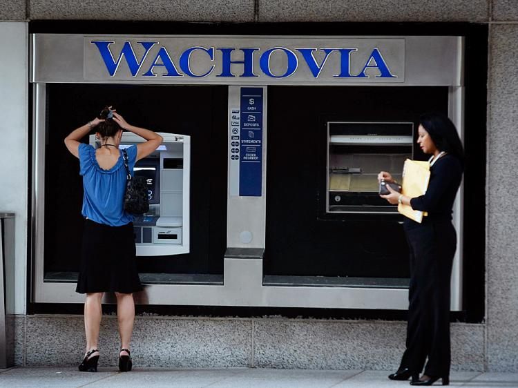 People use an ATM at a Wachovia bank branch September 29, 2008 in Miami, Florida.   (Joe Raedle/Getty Images)
