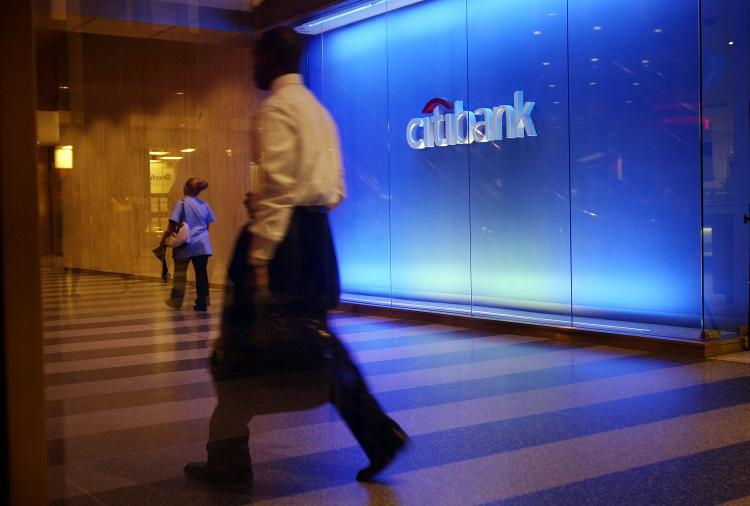 A pedestrian walks by Citibank on July 17, 2009 in New York, New York. (Spencer Platt/Getty Images)