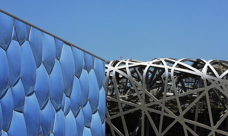 The National Aquatics Center, known as the water cube, stands next to the Beijing National Stadium, known as the bird's nest in Beijing, China.  (Feng Li/Getty Images )