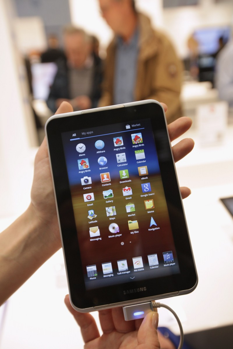 CLOUD POWER: A stand hostess holds up a Samsung tablet PC on the first day of the CeBIT 2012 technology trade fair on March 6th, 2012 in Hanover, Germany. Advances in cloud computing and security were major features at the fair this year